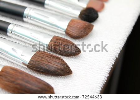 Make-up brushes after washing on towel, close up
