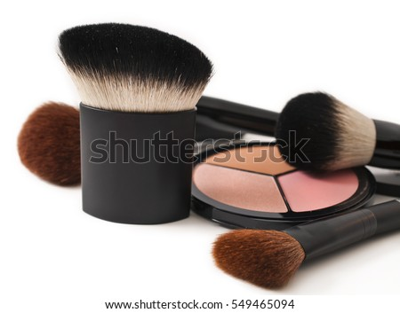 Make-up brushes and cosmetics isolated on white background
