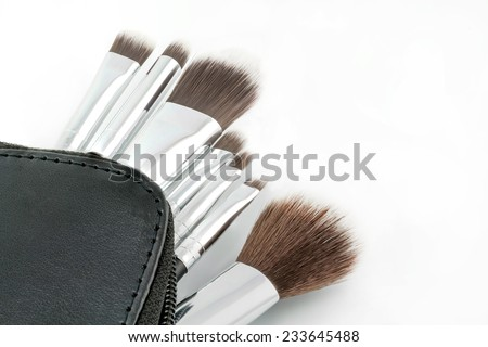 make-up brushes on white background