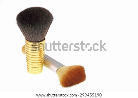 make up brushes over white - stock photo