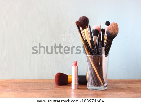 make up brushes over wooden table  - stock photo