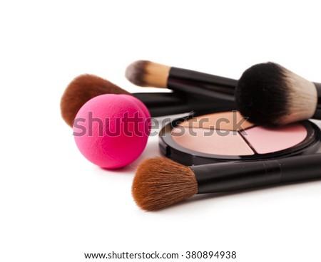 Make-up brushes, pink sponge and cosmetics isolated on white background - stock photo
