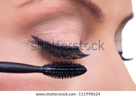 Make-up, close up of long eyelashes and brush mascara, Applying Mascara - stock photo