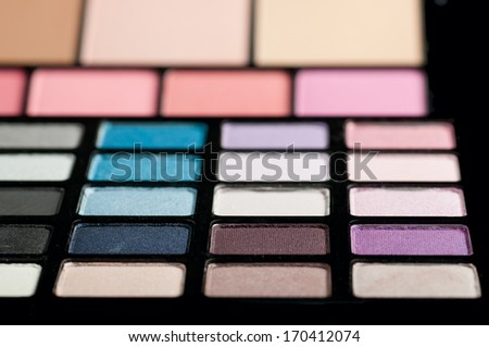 Make-up colorful eyeshadow palettes close up - stock photo