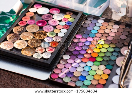 Make-up colorful eyeshadow palettes in use - stock photo
