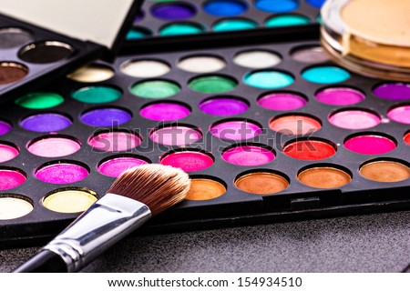 Make-up colorful eyeshadow palettes with makeup brush. Closeup - stock photo