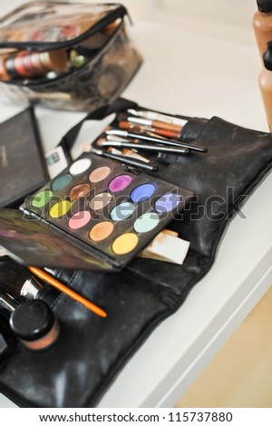 Make-up colorful eyeshadow palettes with makeup brushes .cosmetics - stock photo