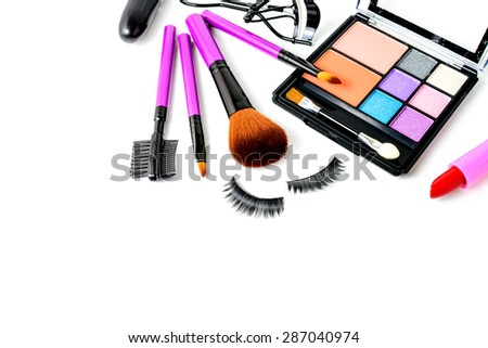Make up cosmetic and brushes isolated on white background - stock photo
