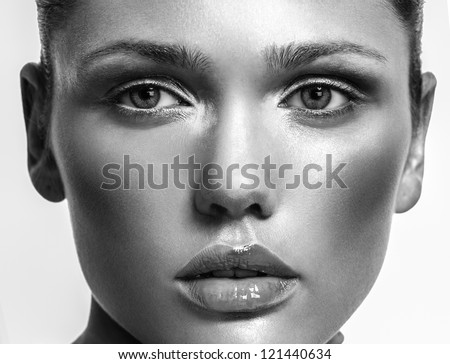 Make-up cosmetics,  Closeup portrait in of beautiful woman model face with clean skin on white background. Natural skincare beauty, clean soft skin - stock photo