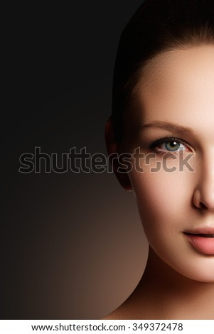 Make-up & cosmetics. Closeup portrait of beautiful woman model face with clean skin. Natural skincare beauty, clean soft skin. Spa treatment - stock photo