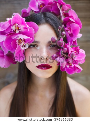 Make up. Flowers. Eyelashes extensions. Perfect Make-up closeup. Cosmetic Eyeshadows, eyebrows. Beauty Girl with Perfect Skin. Eyelashes. Makeover. Spring. Outdoor.