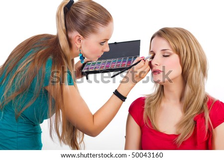 Make-up girl during her job - white backgroung