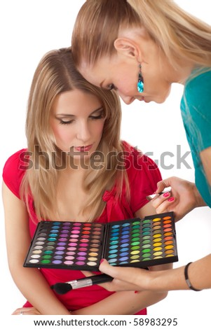Make-up girl showing range of colors - isolated on white background