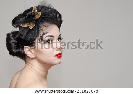 make-up, hairstyle and red lips. Beautiful woman model with makeup and romantic look. Portrait of beautiful brunette woman.  Retro portrait of a beautiful woman. Vintage style. Fashion photo  - stock photo