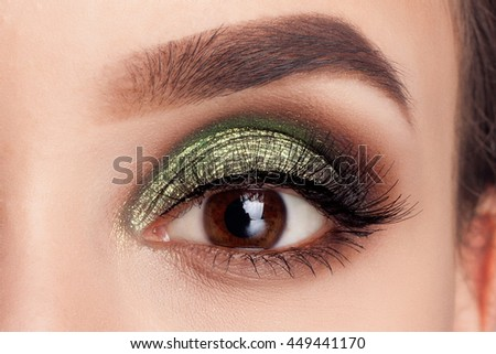 Make-up of woman eye with khaki eyeshadow. Beauty portrait of a girl model with make-up,green eyes. Creative Professional makeup: green eye shadow. open the eyes - stock photo