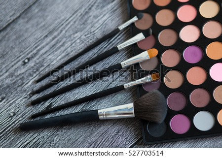 make up palette and brushes