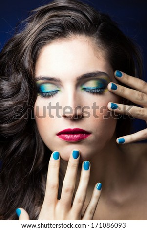 Make up portrait of Sexy Beauty Girl with Red Lips and blue Nails