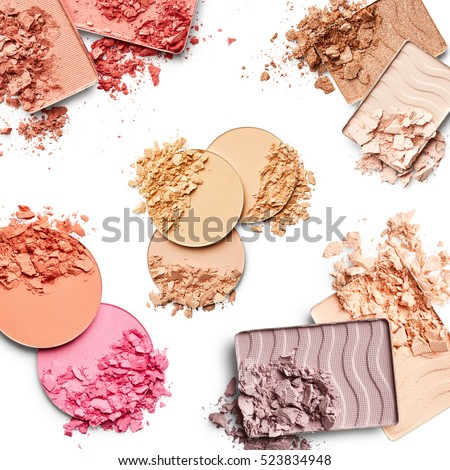Make up set. Face powder, eye shadow and blush isolated on white background