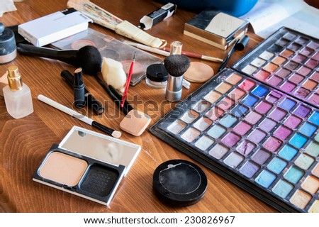 Make-up tools on a wooden table