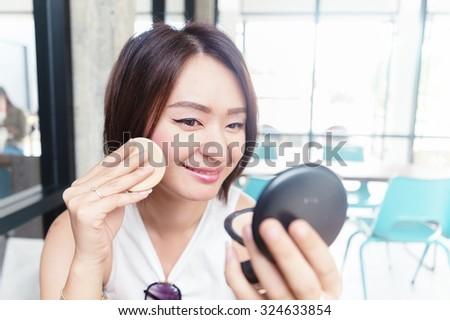 make up woman holding powder puff - stock photo