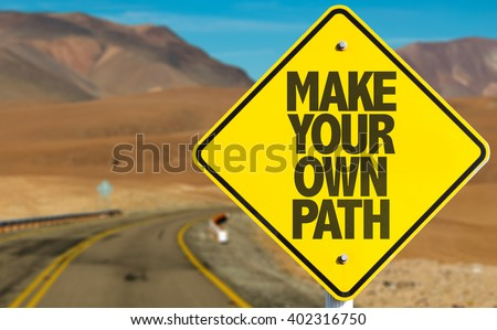 Make Your Own Path sign on desert road - stock photo