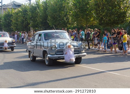 Makeevka, Ukraine - August 25, 2012: Retro cars depicting a wedding procession in the parade during the celebration of the city day - stock photo