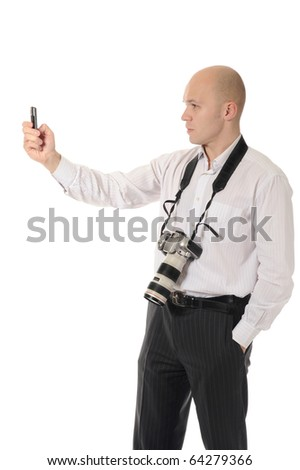 makes the photo on his phone. Isolated on white background - stock photo