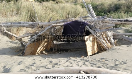 Makeshift shelter on a beach - stock photo