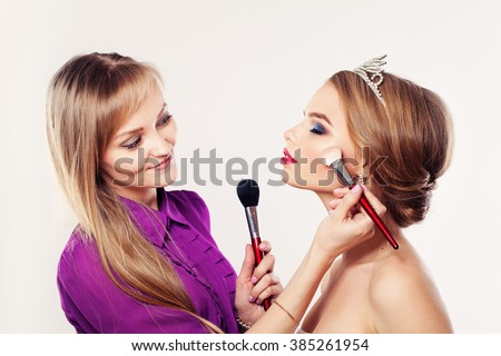Makeup Artist Girl Applying Powder and Blush. Fashion Beauty Concept - stock photo