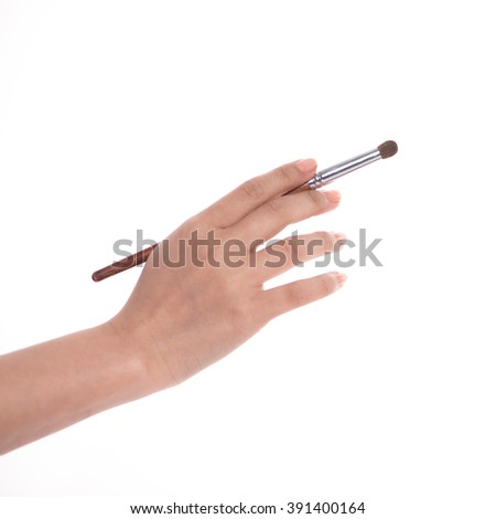 Makeup artist holding the tools of  - stock photo