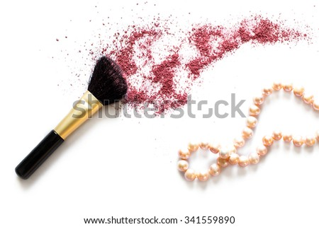Makeup brush and blusher sample with necklace on white background. Woman's Day. March 8. - stock photo