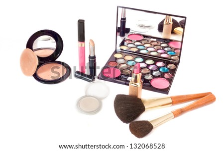 Makeup brush and cosmetic on a white background