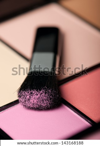 makeup brush and cosmetic powder close up - stock photo