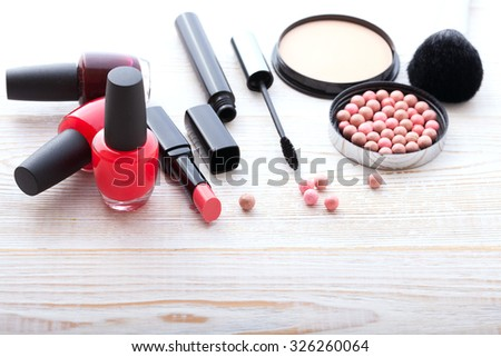 makeup brush and cosmetics make up artist objects: lipstick, eye shadows, eyeliner, concealer, nail polish, powder, tools for make-up