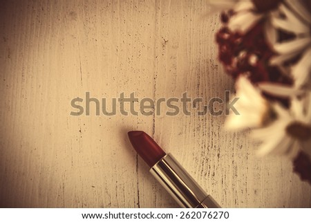 makeup brush and cosmetics on white wooden table - stock photo