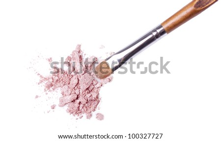 makeup brush and eyeshadow isolated on white