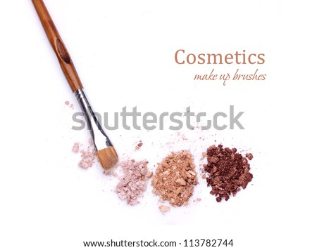 makeup brush and multicolored eye shadows isolated on white background - stock photo