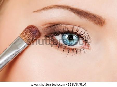 makeup brush eyeshadow on eyelid - stock photo