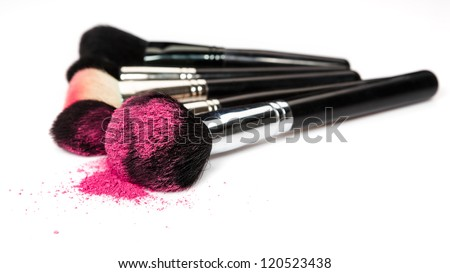 makeup brushes and cosmetic powder - stock photo
