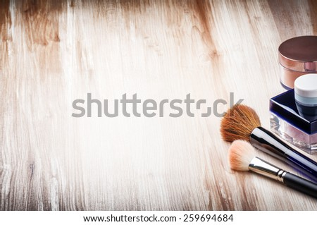 Makeup brushes and face powder  - stock photo