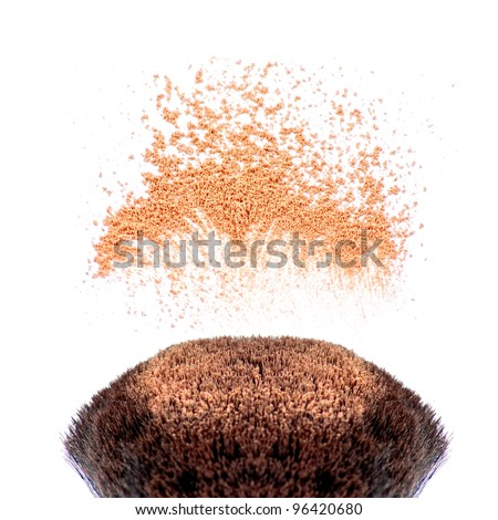 Makeup brushes and powder in motion - stock photo