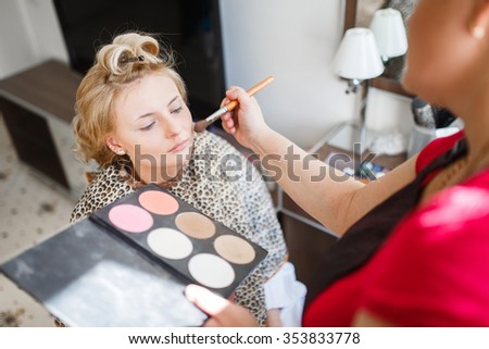 makeup brushes, closeup. Makeup artist working outdoor events