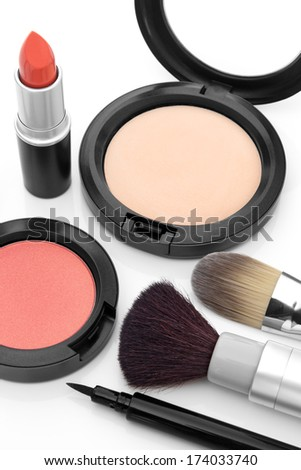 Makeup brushes, face powder, blush, lipstick and liquid eyeliner.