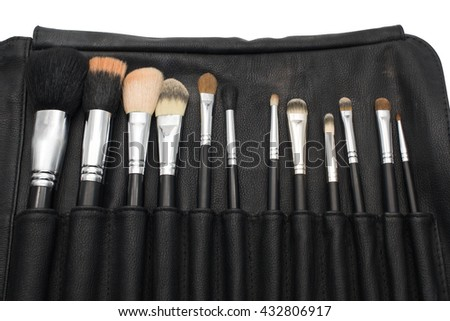 Makeup brushes in black brush holder