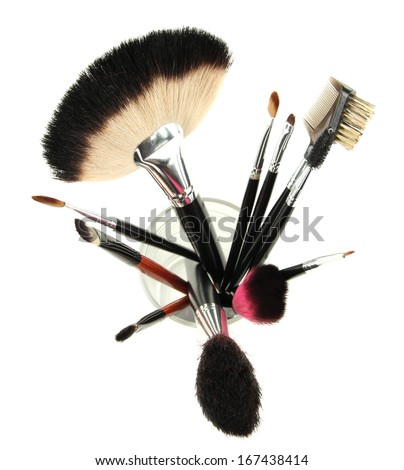 Makeup brushes in glass isolated on white - stock photo