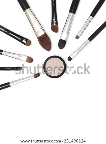 makeup brushes of different sizes eyes shadow white background - stock photo