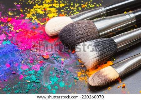 Makeup brushes on a colorful background with copy space - stock photo