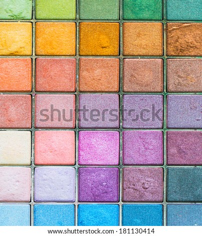 Makeup colorful eyeshadow palettes as background - stock photo