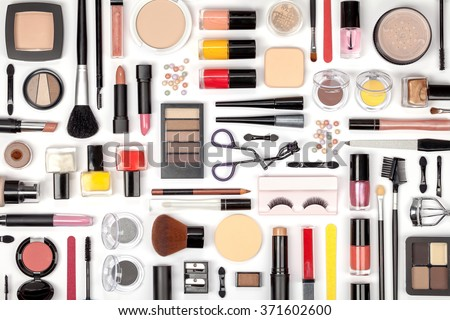 makeup cosmetics, brushes and other essentials on white background top view. beauty flat lay concept - stock photo