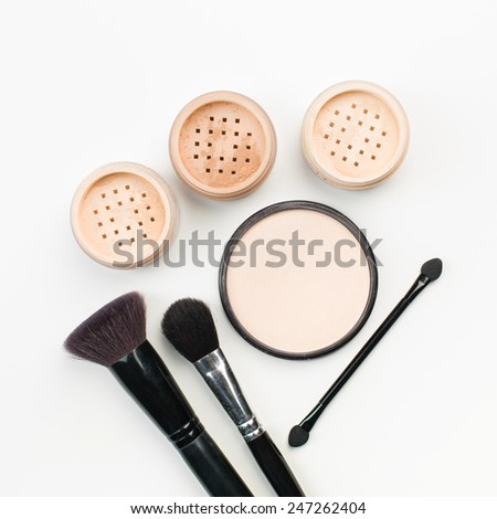 makeup cosmetics. compact powder, mineral foundation and makeup brushes - stock photo